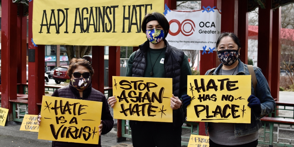 Marchers holding signs at AAPI anti-hate crime rally 3-14-21