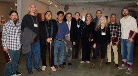 "Professor Flores with Chicano/a artists at ""Beyond Aztlán."""